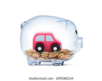 Car toy on coins inside transparent piggy bank with clipping path