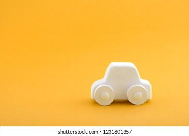 Car toy on orange background