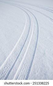 car track on snowy ground