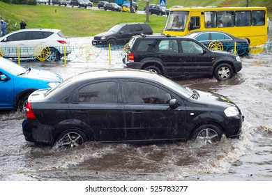 Car traffic in a heavy rain on a flooded city road