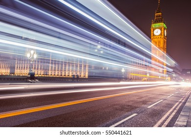 Car traffic light trails by Big Ben clock tower in Westminster, London at night