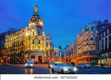 Car and traffic lights on Gran via street, main shopping street in Madrid at night. Spain, Europe.