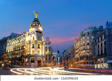 Car and traffic lights on Gran via street, main shopping street in Madrid at night. Spain, Europe. Lanmark in Madrid, Spain