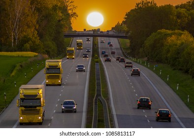 Car traffic on the motorway in Germany before sunset