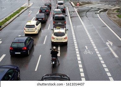 Car traffic on the road of a European city