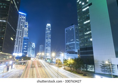 Car trail during Hong Kong dark night with high building