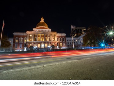 Car Trail Lights in front of the Massachusetts State House