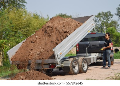 car trailer dumping.