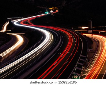 car trails on the road at night