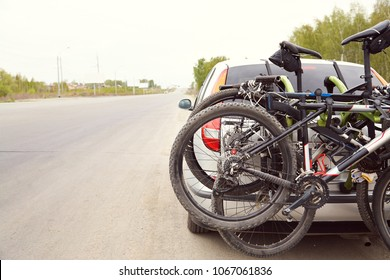 car is transporting bicycles on rack. bikes on the trunk
