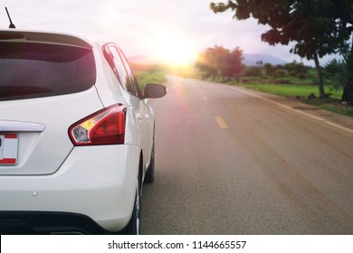 Car for traveling with countryside in summer day. Asphalt road with cars passing through the forest in north of Thailand and sunshine morning. Vacation and travel concepts