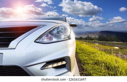 Car traveling in nature on an asphalt road - Front view