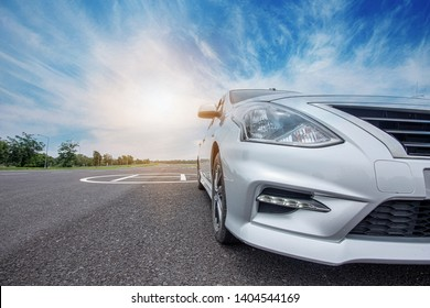 Car traveling in nature on an asphalt road - Front view - Image
