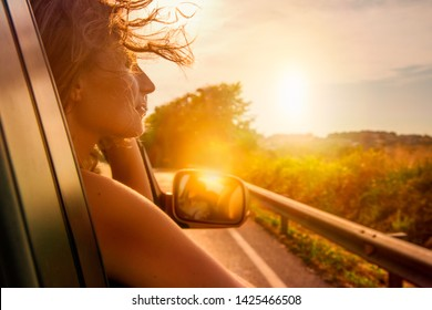 car travelling adventure female out of window