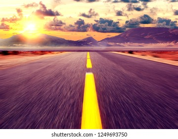 Car travelling and scenic desert road.Adventures and destination concept.Country road background and colorful sunset landscape.
