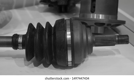 Car tripod CV-joint close up on gear reducer background, automotive transmission spare parts