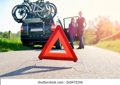 Car Trouble on a Holiday Trip - family is happy about arriving road assistance
