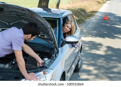Car troubles couple starting cables broken vehicle on the road