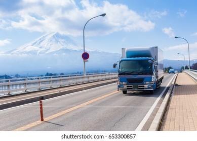 Car Truck Run Through Bridge in Kawaguchiko Lake, Logistics in City, Yamanashi, Japan