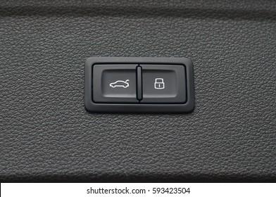 Car trunk close and lock symbols.