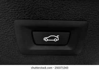 Car trunk closing button. Auto detail interior.