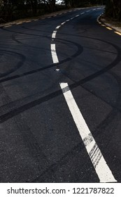 Car tyre skid marks on a rural road