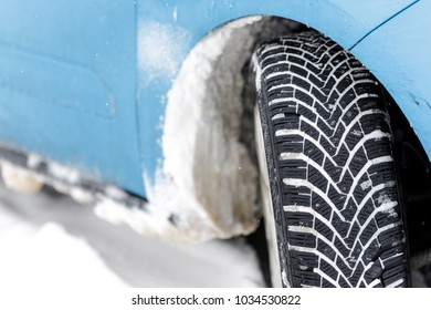 Car tyre in winter covered with snow.On road with fresh snow. close up.