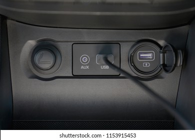 car usb socket, inside with usb black cable in plug