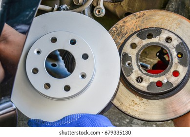 A car used disc brakes pads and new disc brakes pads
