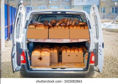 A car van is loaded with fresh hot bread.