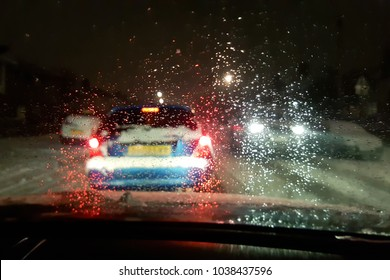 In car view of snow fall storm in the UK causes traffic congestion at night