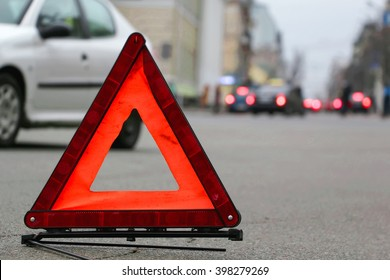 Car warning triangle on the road.