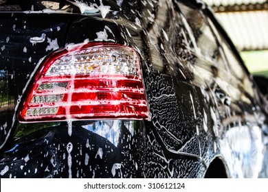 Car wash business that are common in the region of Thailand.Car cleaning by washing.