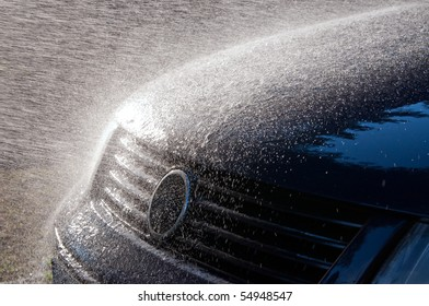 Car Wash with Flowing Water over Car Body
