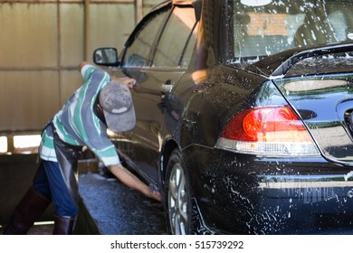 car washing by hand using a foam preparation for polishing,selective focus