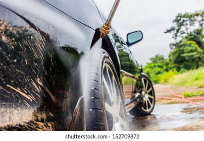 car washing cleaning with foam and hi pressured water