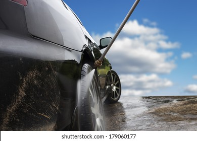 car washing cleaning with hi pressured water  blue sky background