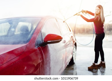 Car washing. Cleaning Car Using High Pressure Water. Selective focus.