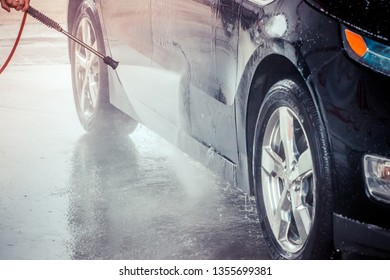 Car washing. Cleaning Car Using High Pressure Water.