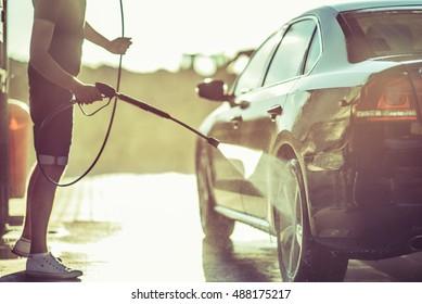 Car Washing and Detailing Photo. Taking Car of a Car.