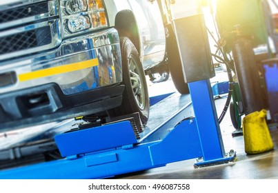 Car Wheel Alignment Check. Large Pickup Truck on the Alignment Equipment in the Car Service.