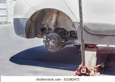 Car Wheel is Being Maintained on Professional Car Repair Station. Horizontal Image Concept
