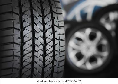 Car wheel closeup, blur background