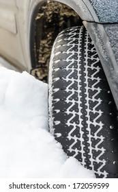 car wheel in deep winter snow snowbank