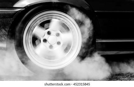 Car wheel drifting and smoking on track