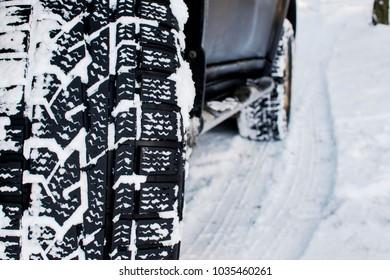 car wheel leaves a mark on the snow