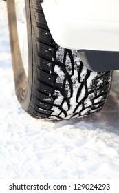 Car wheel on a white snow