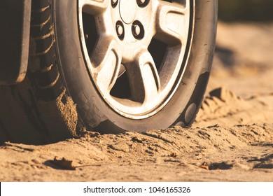 car wheel in the sand, retro toned