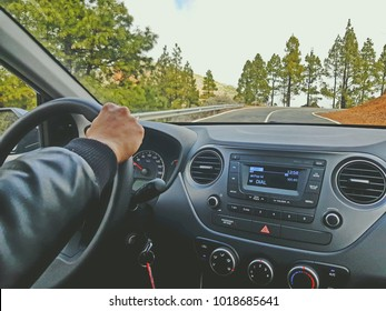 In the car while driving while traveling