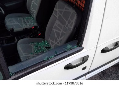 Car window broken by criminals and items stolen from the seat.